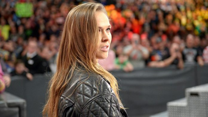 WWE Elimination Chamber: Ronda Rousey destroys Triple H while Roman Reigns wins