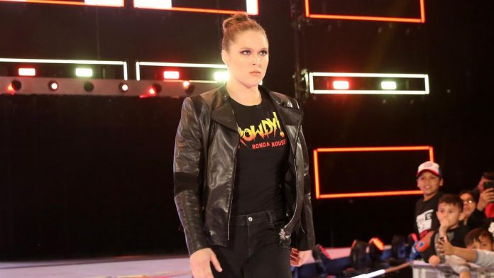 Ronda Rousey Slams Triple H Through Table At Elimination Chamber
